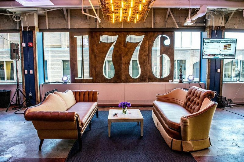 Two comfortable couches in front of 1776 cutout on wall