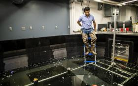 Penn Engineer testing an ocean simulating indoor pool