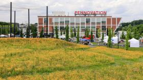 Image of the Pennovation Center and a flowering meadow